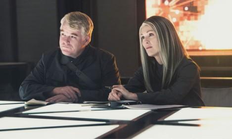 Phillip Seymour Hoffman as Plutarch Heavensbee & Julianne Moore as Alam Coin